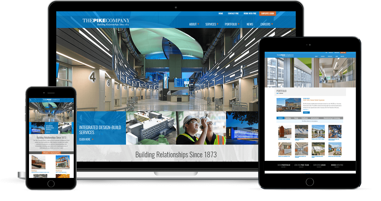 Pike Construction Website Design. Laptop with homepage (center), smartphone (left), and tablet display (right),